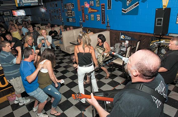 10:38 p.m.- The band 3 Bad Men keeps the crowd rocking at McCook's Lakeside Sports Grill.