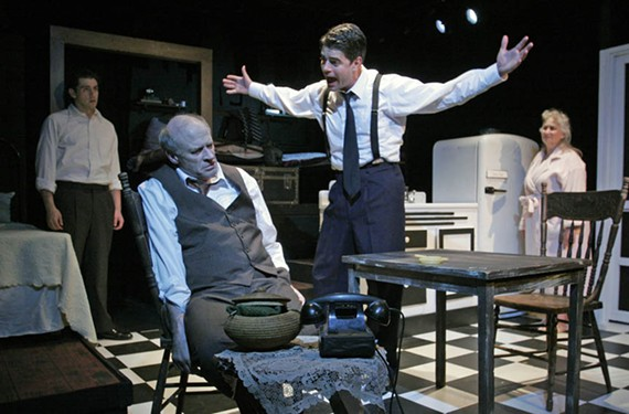 A bummed Willy Loman (Joe Inscoe) sits surrounded by his family, (from left) Happy (Matt Bloch), Biff (Adrian Rieder), and his wife, Linda (Jacquelline Jones). - FIREHOUSE THEATRE