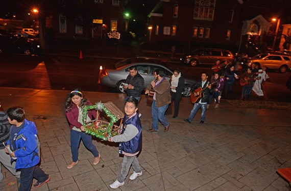 A candlelight procession at Sacred Heart Catholic Church is part of a nine-day posada, recreating the Bethlehem pilgrimage in song.