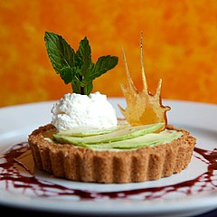 A coconut-vanilla wafer crust, tuille, and red wine-cinnamon reduction accent the avocado tart. Photo by Scott Elmquist.