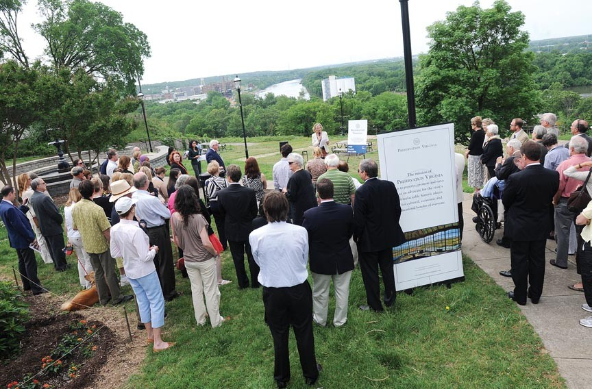 A crowd gathers in Libby Hill Park Monday morning to hear Preservation Virginia's list of the 11 most endangered sites in the state — which includes the park overlook. - SCOTT ELMQUIST