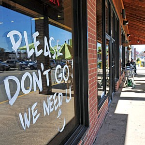 A customer etched a sign of support in front of Blockbuster, next to Ellwood Thompson's. Photo by Scott Elmquist.