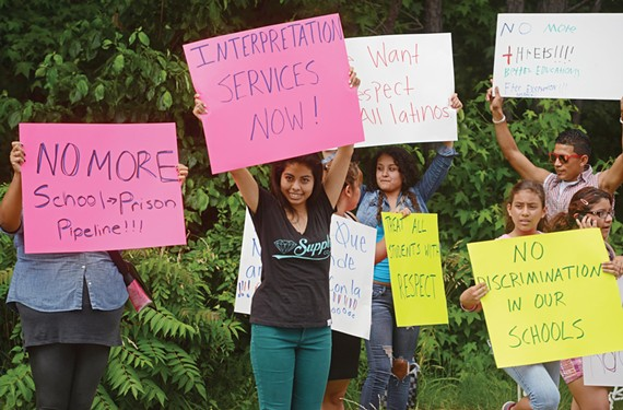 A day after Huguenot High School graduation, students join parents and others in a protest against what they say is unfair treatment of Latinos at the school. - SCOTT ELMQUIST