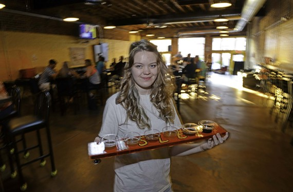A flight of beer goes out at Isley Brewing Co., delivered by general manager Alexandra Tilbe.