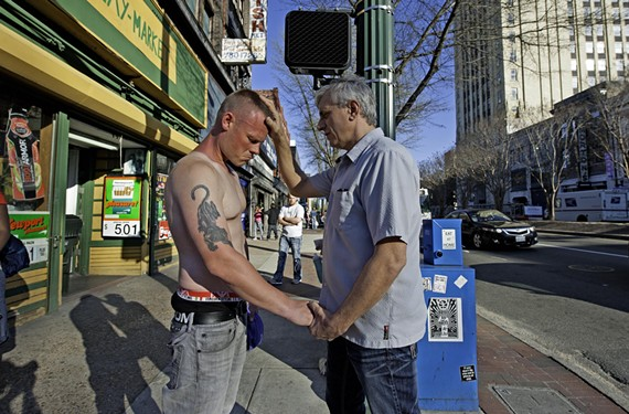 A former regular in Richmond's early punk and hardcore scene, Mike Rodriguez (right) has turned his life around. Through his Spirit and Truth Ministries, he now reaches out to others, such as J.W. Holland at Second and Broad Streets.