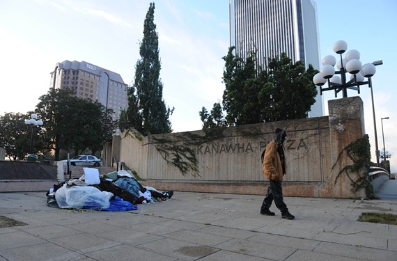 A homeless man looks for his bike after police raided the Occupy Richmond camp in October 2011. The number of homeless people on the street has fallen by 20 percent since last summer. - SCOTT ELMQUIST