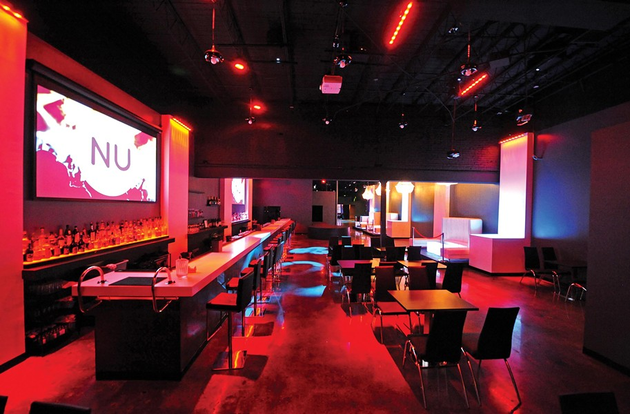 A long white acrylic bar, upscale lighting system and complete interior redesign at the former Nations gives Nu Nightclub a fresh face as the city's newest dance club. - SCOTT ELMQUIST