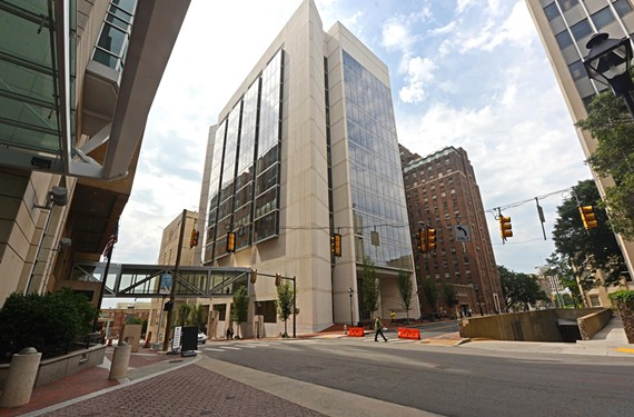 A pedestrian crosses East Marshall Street toward the new James W. and Frances C. McGothlin Medical Education Center which complements the art deco West Hospital on the VCU medical campus. - SCOTT ELMQUIST