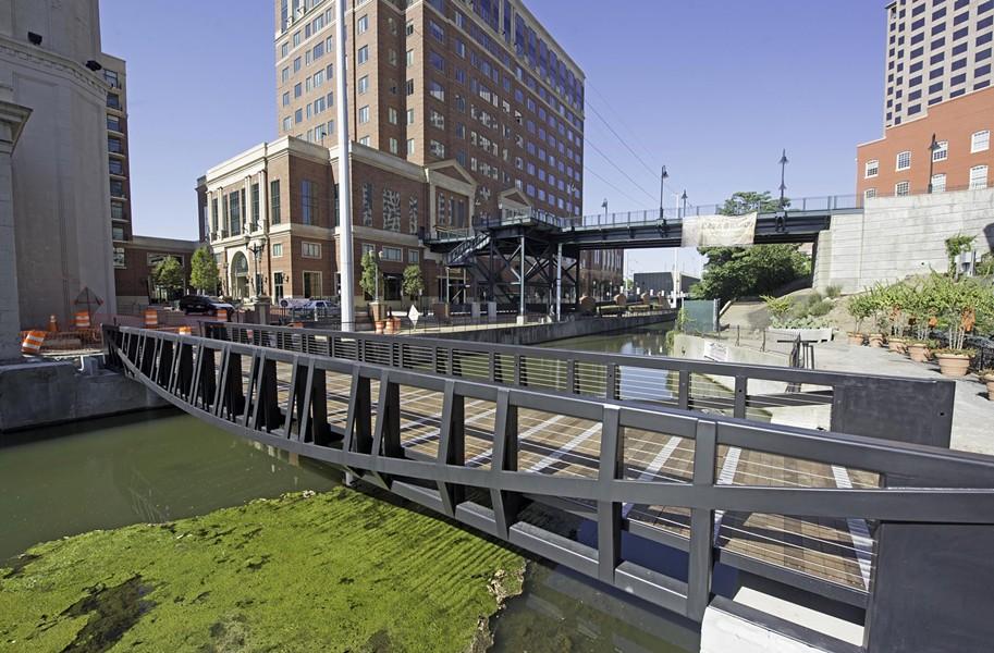 A recently installed foot bridge crosses the Haxall millrace on the Canal Walk near South 12th Street. - SCOTT ELMQUIST