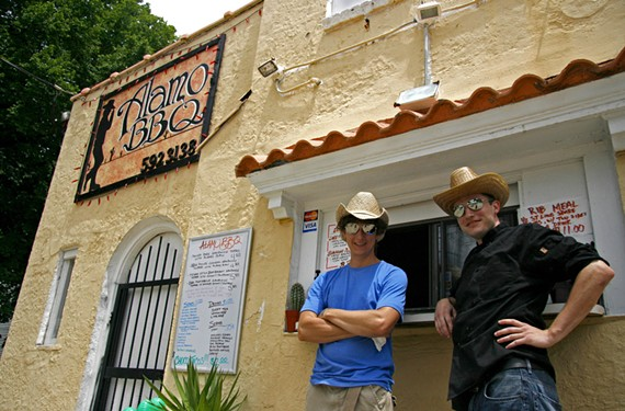 A turning point for the Church Hill neighborhood came with Alamo BBQ, where Chris Davis and Paul Hubbard play up their theme at the 2009 opening. - CHRISTINE LOCKERBY