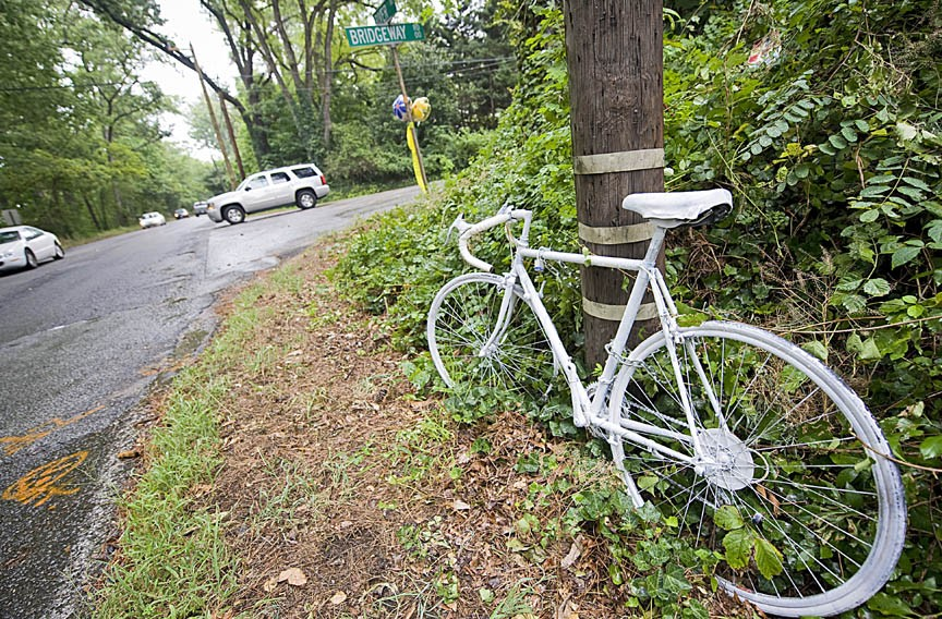 A white-painted ghost bike marks the place on River Road where Lanie Kruszewski was struck and killed by a hit-and-run driver. - ASH DANIEL
