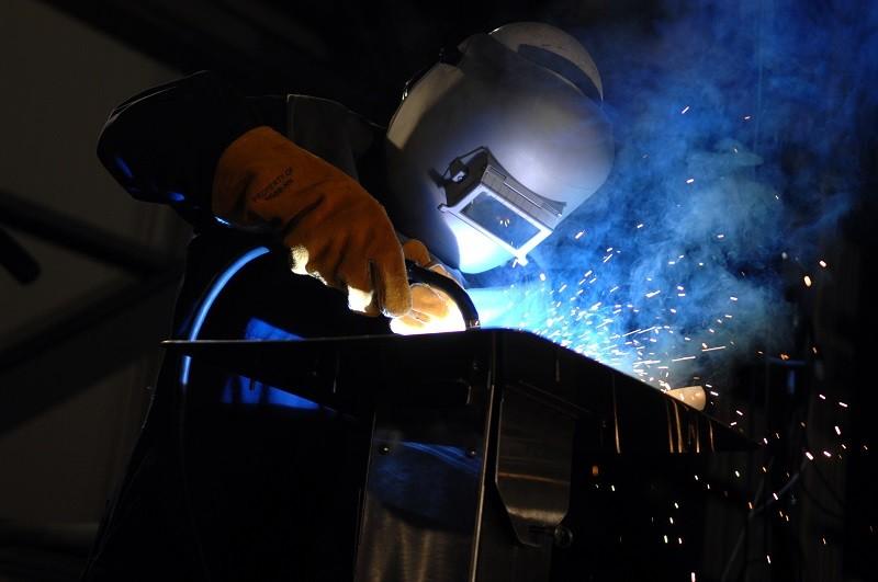A worker welds the keel of an aircraft carrier at Northrop Grumman Shipbuilding in Newport News. - U.S. NAVY