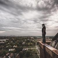 "Jamie Betts Photography ""Above."" Friend on the summit of Lee Plaza in Detroit. Scott Elmquist"