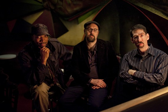 Acclaimed jazz pianist Fred Hersch is pictured far right in this photo with his trio.