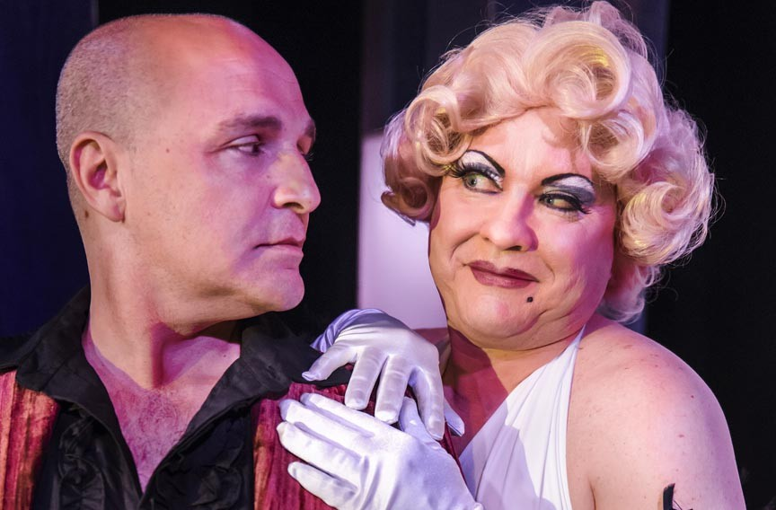 """Actor Matt Beyer stars as Georges and Kirk Morton plays his wife, Albin, in the Tony-winning musical which translates literally to """"the cage of mad women."""" - JOHN MACLELLAN"""