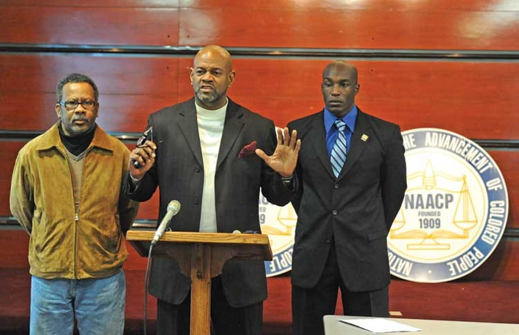 Administrators at the Richmond Juvenile Detention Center are covering up unsafe conditions, NAACP head King Salim Khalfani (center) told reporters last week. - SCOTT ELMQUIST