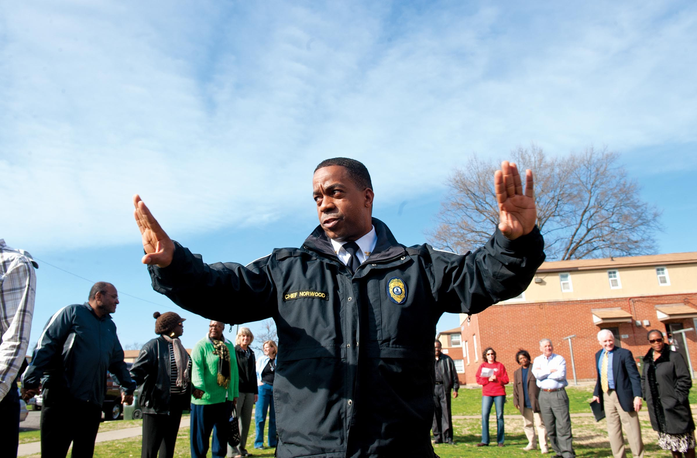 After a rash of slayings in Hillside Court early last year, Police Chief Bryan Norwood led a healing session with residents and officials. - SCOTT ELMQUIST