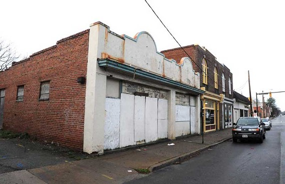 After demolishing these two vacant storefronts, the city plans to hire a consultant to re-imagine Brookland Park Boulevard. - SCOTT ELMQUIST