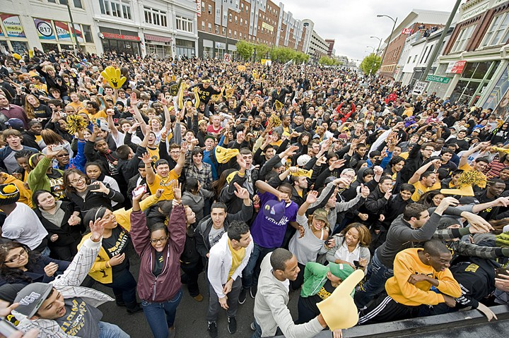 After VCU knocks off Kansas, VCU students and fans pour into the streets, taking over West Broad Street. Tens of thousands celebrate downtown, chanting and reveling in a victory march toward Monroe Park. - SCOTT ELMQUIST