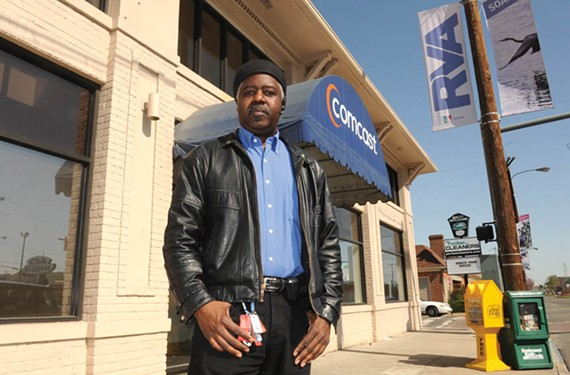 """A.J. Johnson, standing outside Comcast's public-access studio on North Boulevard, says public access is in peril. """"I don't think the majority of people realize that it could go away,"""" he says."""
