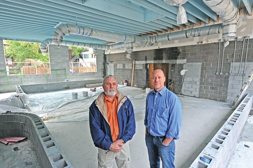 Alan delForn and Todd Boyd stand in the construction zone that will be the garden room focal point of their new project, Selba, coming this summer to the Fan. - SCOTT ELMQUIST
