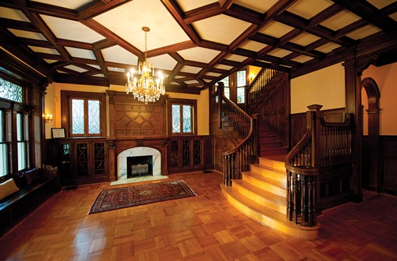 All of the interior surfaces, including the side paneling, fireplace, coffered ceiling and parquet floors of the stair hall at 2710 Monument Ave. were refinished. - SCOTT ELMQUIST