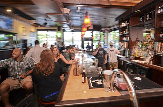 Although Buddy's Place has a new executive chef, it's still a neighborhood joint where you can grab a beer.