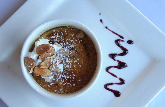 Amaretto pumpkin crème brûlée is one of a series of knock-out desserts at Hermitage Grill in Lakeside. - SCOTT ELMQUIST