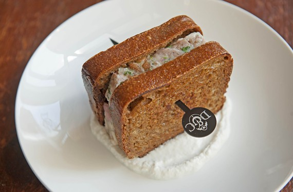 Among the intriguing appetizer choices at Dutch & Co. is the pig face and pickled mushroom terrine on SubRosa bread with horseradish yogurt. - SCOTT ELMQUIST