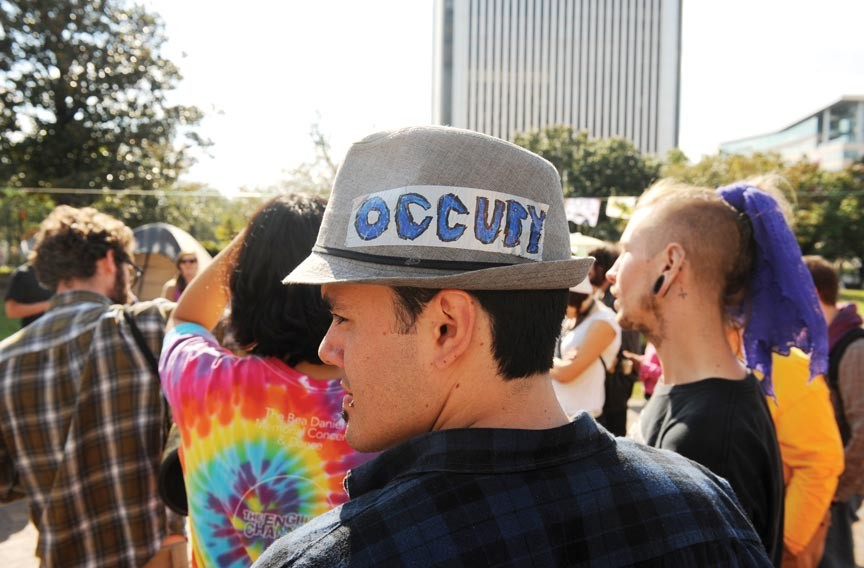 An Occupy Richmond protestor, Santos Felipe Ramos, at Kanawha Plaza last week. - SCOTT ELMQUIST