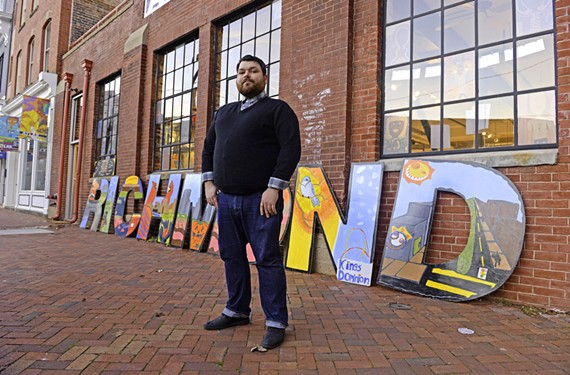 Art 180 program manager Michael Guedri stands in front of its Jackson Ward building. This month there will be an exhibition of paintings on vintage windows and autobiographical 'zines.