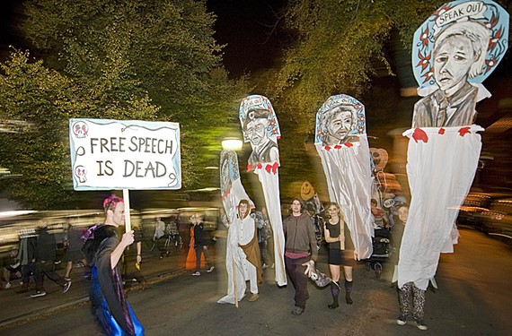 "Artist Lily Lamberta's giant puppets are featured in her annual All the Saints Theater Company's Halloween parade. After the ""Funeral March for Free Love and Speech,"" her Edward Snowden puppet disappeared."