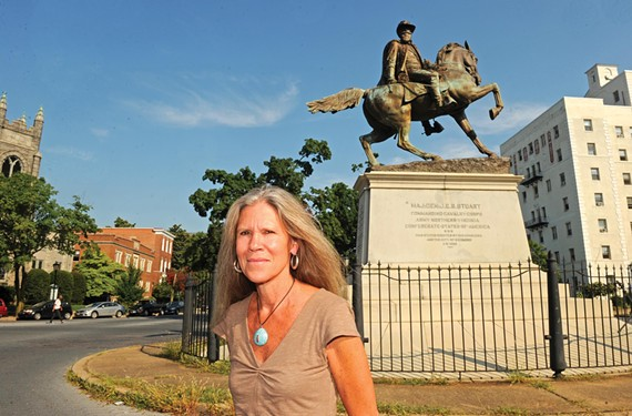 "Ashley Kistler stands in front of the J.E.B. Stuart statue in Stuart Circle. ""There shouldn't be a disconnect between architecture, urban planning and public art,"" says the director of the Anderson Gallery at Virginia Commonwealth University. - SCOTT ELMQUIST"