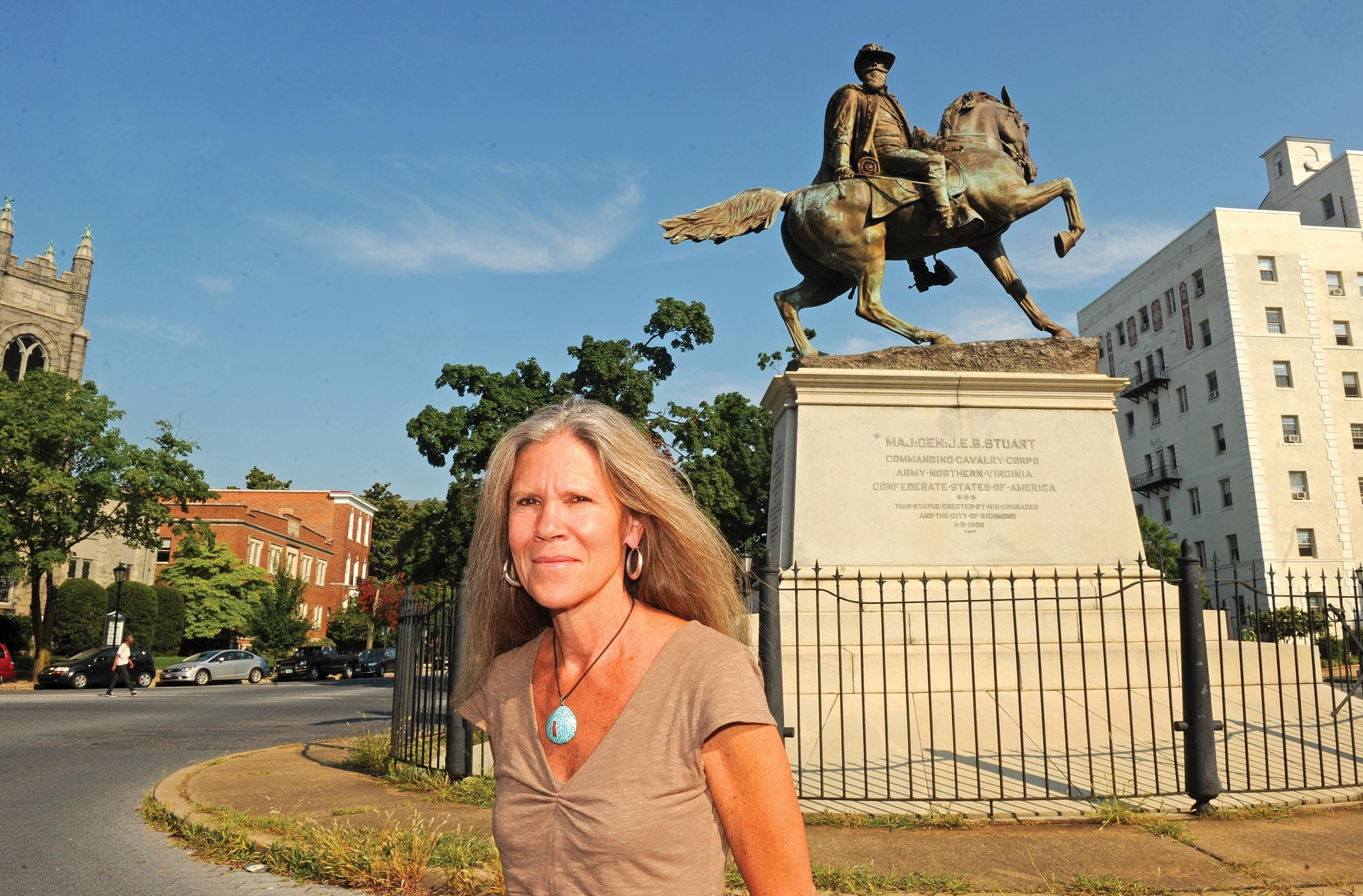 """Ashley Kistler stands in front of the J.E.B. Stuart statue in Stuart Circle. """"There shouldn't be a disconnect between architecture, urban planning and public art,"""" says the director of the Anderson Gallery at Virginia Commonwealth University. - SCOTT ELMQUIST"""