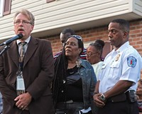 At a vigil for Lewis James Johnson Jr., Richmond police Capt. Brian Russell, left, with Alicia Rasin and Chief Bryan T. Norwood, asks onlookers for information that could help the young man's killing.