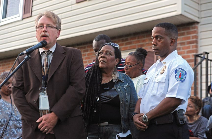 At a vigil for Lewis James Johnson Jr., Richmond police Capt. Brian Russell, left, with Alicia Rasin and Chief Bryan T. Norwood, asks onlookers for information that could help the young man's killing. - SCOTT ELMQUIST