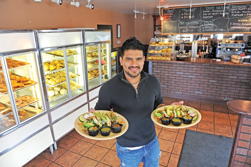 At Café Pandulce, owner Miguel Morales shows off the carne asada and chicken tacos. His business intends to put a Latin spin on typical American counter service cafes. - SCOTT ELMQUIST
