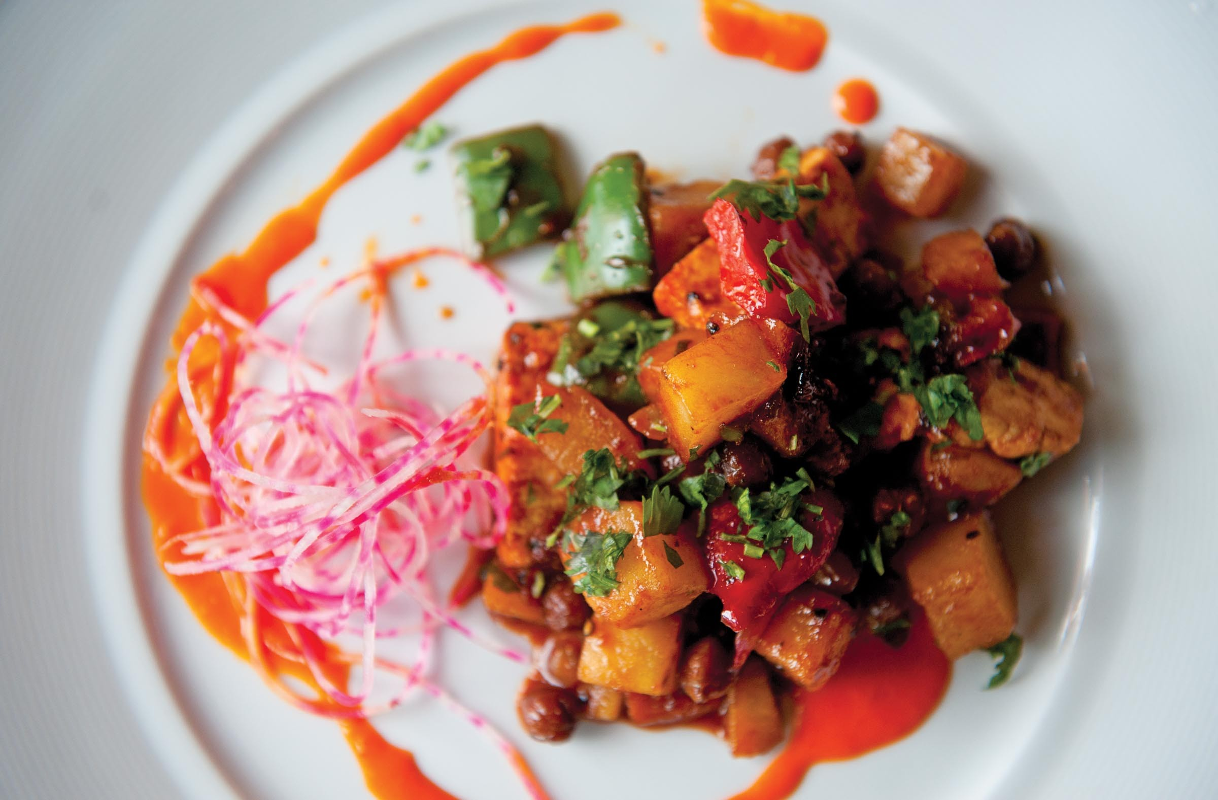 At Curry Craft in Carytown, the tak a tak includes chunks of spiced paneer, potatoes, assam tea-marinated garbanzos and a zesty glaze. - SCOTT ELMQUIST