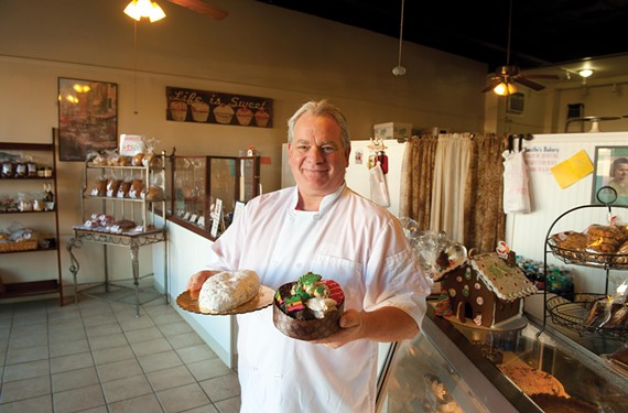 At Lucille's Bakery, owner and pastry chef Gerald Fortin shows the Christmas stollen, a traditional bread with almonds, candied fruit, almond paste, raisins and brandy, and a selection of Italian cookies for the holidays. - SCOTT ELMQUIST