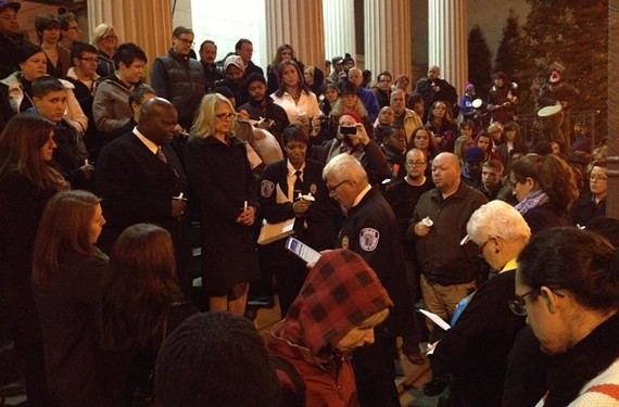 At the Transgender Day of Remembrance on Nov. 20, attendees gather around Richmond Police Chief Ray Tarasovic while he reads a proclamation honoring the event, held at St. Paul's Episcopal Church. - TOM NASH