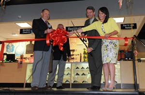 Attorney General Ken Cuccinelli helps cut the ribbon at Colonial's grand opening. - SCOTT ELMQUIST