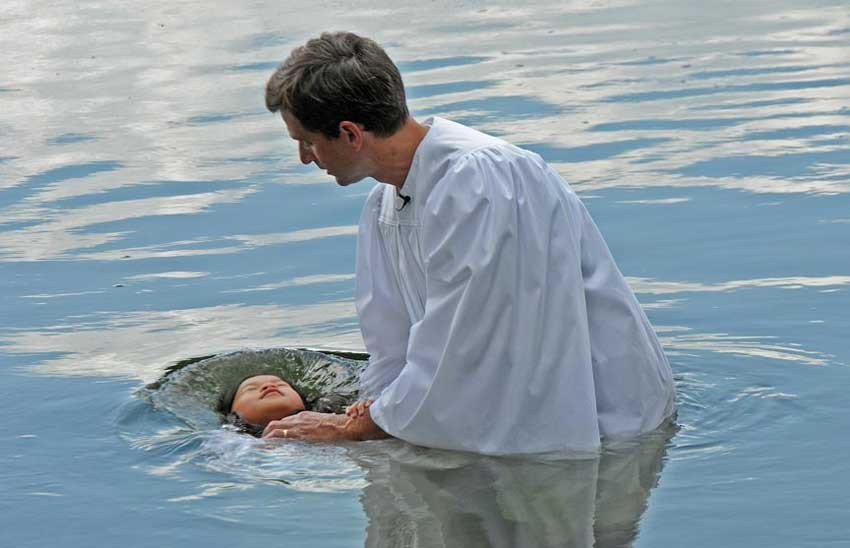 """Baptism,"" published July 27. Leah Mei Ward, age 8, is baptized in the James River by Jim Sommerville, senior pastor of First Baptist Church. - SCOTT ELMQUIST"