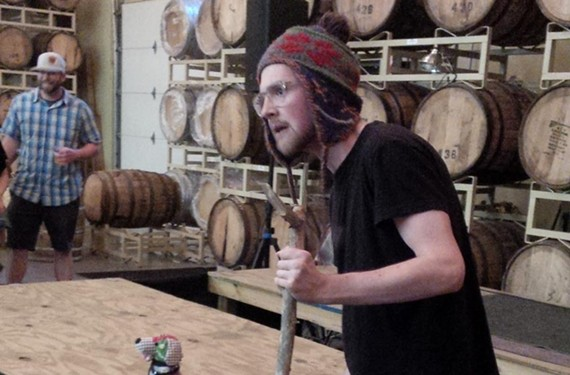 Bard Ubound actor Dixon Cashwell delivers the lines of William Shakespeare at Hardywood Park Craft Brewery with the help of a knit puppy in chain mail.