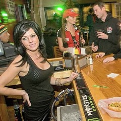 Bartender Heather McCannon serves the late-nighters at City Dogs on West Main Street. Photo by Ash Daniel.