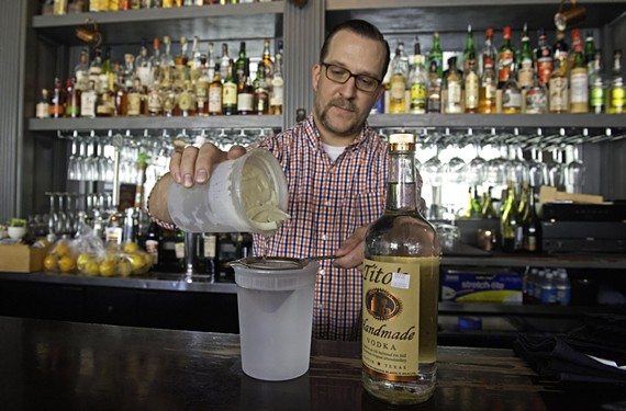 Bartender T Leggett mixes a bacon washed Bloody Mary at the Roosevelt.