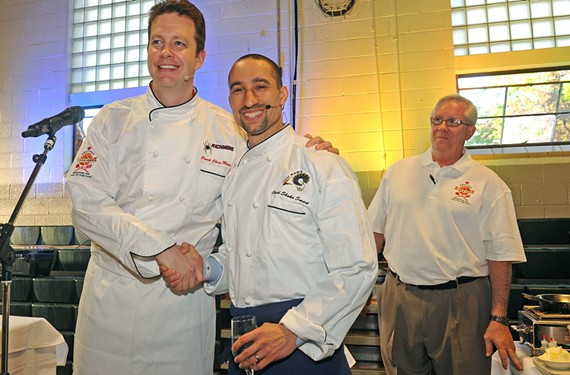 Basketball coaches Chris Mooney and Shaka Smart, shown at last year's coaches' cook-off, compete again April 17. The benefit for Positive Vibe Café is a serious fundraiser but a good time for guests. That's Positive Vibe founder Garth Larcen in the back.