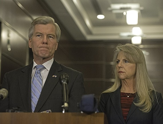 Bob and Maureen McDonnell stand together Tuesday night as the former governor reads a statement in the lobby of Williams Mullen, a downtown law firm.