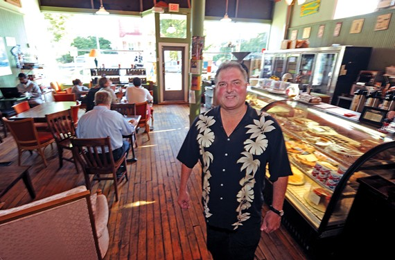 Bob Buffington stands in his Church Hill coffee shop, Captain Buzzy's Beanery.