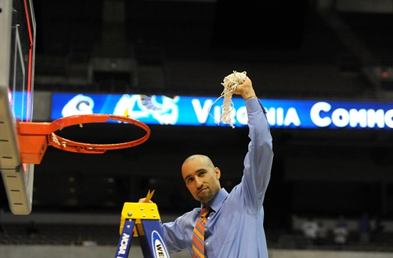 Breaking up is hard to do: Shaka Smart helps cut down the nets in 2011, when the VCU Rams became the Southwest Regional champions in San Antonio. (File Photo)