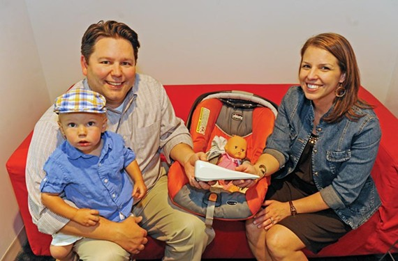 Brian and Ashley Harding, with their son Camden, invented the Dozer, an automatic rocker that gives parents a break from jiggling the car seats of fussy babies. - SCOTT ELMQUIST